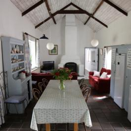 Cottage living area with fire stove at Ballymaloe Cookery School